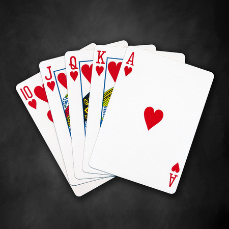 flush: A royal straight flush playing cards poker hand in hearts