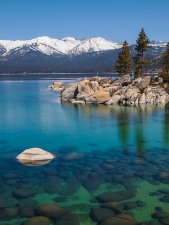 clear water: Scenic view of beautiful Lake Tahoe in Spring, landscape of the United States of America, clear water, nice sky,  stone island, tree, fresh air and snow mountains