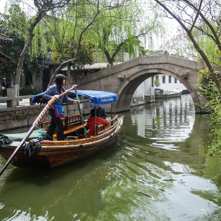 zhouzhuang: ZHOUZHUANG, SHANGHAI - April 11, 2011 : Zhouzhuang, the ancient water village is Shanghai tourist attraction with 1,000,000 visitors per year and there are a lot of variety activities have done here. Editorial