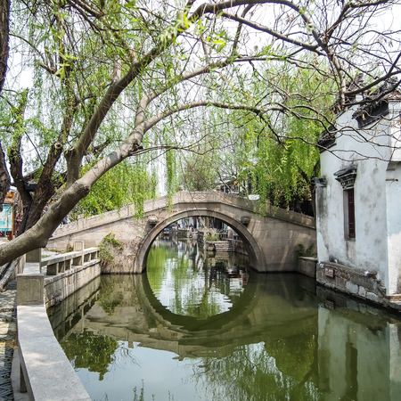 ZHOUZHUANG, SHANGHAI - April 11, 2011 : Zhouzhuang, the ancient water village is Shanghai tourist attraction with 1,000,000 visitors per year and there are a lot of variety activities have done here. Stok Fotoğraf - 48740811