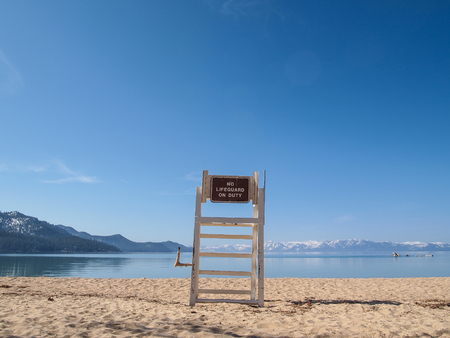 lifeguard chair stand on the shore of lake Tahoe. Stock Photo