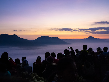 Many travellers looking at Sunrise and fog over Phu Thok Mountain at Chiang Khan ,Loei Province in Thailand.