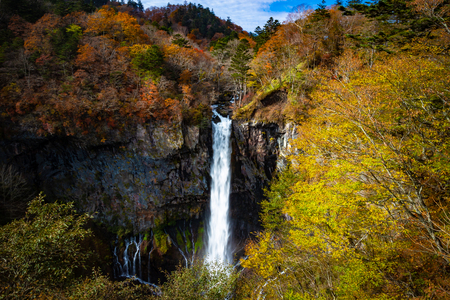 The Kegon Falls near Nikko, Japan surrounded by autumn colours