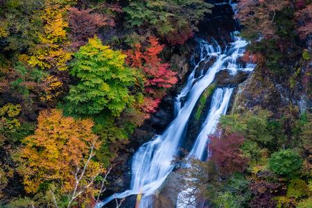 Kirifuri waterfalls and Beautiful romantic maple leaves in autumn landscape at Senoo, Nikko, Tochigi Prefecture. autumn natural background