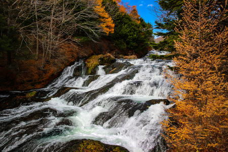 Ryuzu waterfall (Ryuzu no taki )or dragon head waterfall, water fall located on Yukawa River in Nikko national park, many autumn trees which turn yellow and red during the autumn leaf season in Japan