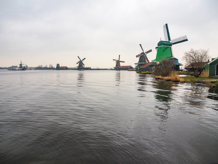 Historic windmills at Zaanse Schans ,neighborhood in the Dutch town of Zaandam, near Amsterdam,  The Netherlands.