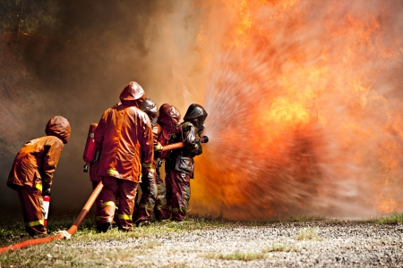 Firefighters fighting fire during training  Stock Photo - 11533175