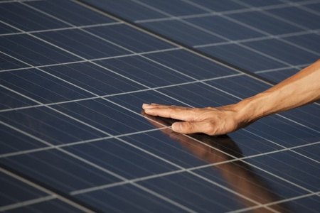 Hand of the man touching Solarcell. photo