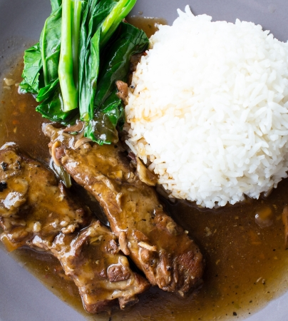 Pork ribs with sauce and cooked rice  photo