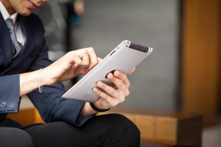 Young businessman using digital tablet pc