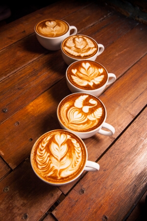 Latte art, coffee on the wooden desk as background  photo