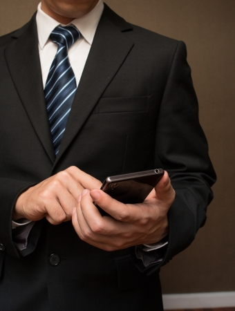 Close up of a man using mobile smart phone  Banque d'images