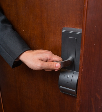Hand of businessman open door in the hotel   photo