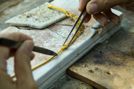 Goldsmith working with a unfinished work  Banque d'images