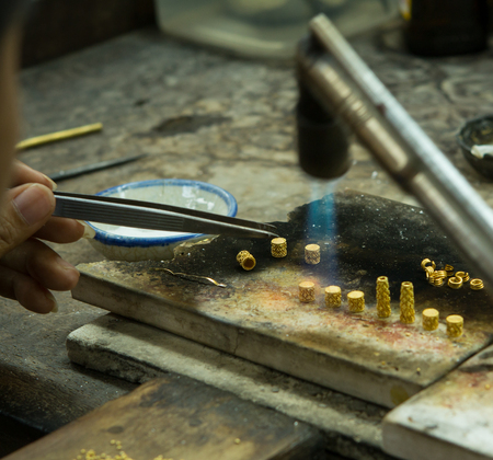 grimy: Goldsmith working with a unfinished work  Stock Photo