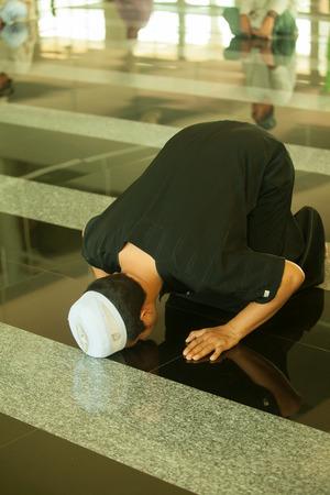 madina: Muslim praying in mosque  Stock Photo