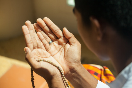 Praying hands of muslim boy