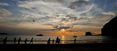 People play football on the beach   photo