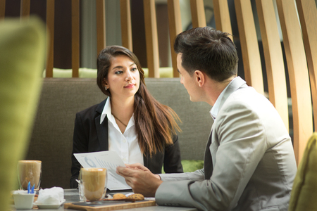 Young attractive woman discuss with her colleague.Business interview concept.