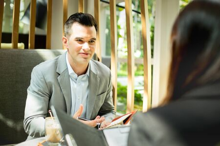 Young attractive businessman during job interview in the coffee shop. Banque d'images
