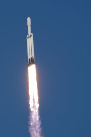 CAPE CANAVERAL, USA - APRIL 11, 2019: SpaceX Falcon Heavy successfully launches to deploy Arabsat-6A satellite into orbit. Viewed from Kennedy Space Center's Banana Creek Launch Viewing Area
