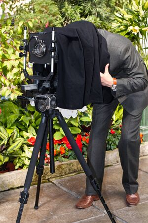 The photographer photographs the old camera on a large format. Stock Photo