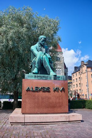 HELSINKI, FINLAND - JULY 17, 2015: Sculpture of Aleksis Kivi on Rautatientori Square. Editorial