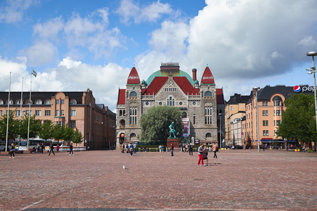 HELSINKI, FINLAND - JULY 17, 2015: Finnish National Theatre in central Helsinki on the northern side of the Helsinki Central Railway Station Square