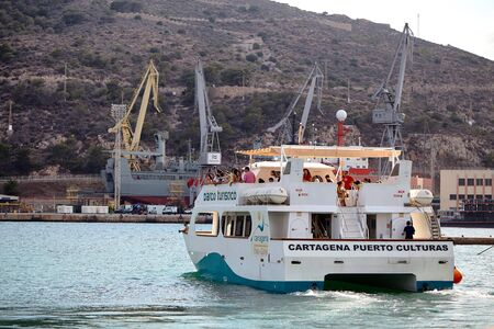 Cartagena, Spain - July 13, 2016: Excursion in a tourist boat along the Mediterranean Sea in the vicinity of Cartagena.