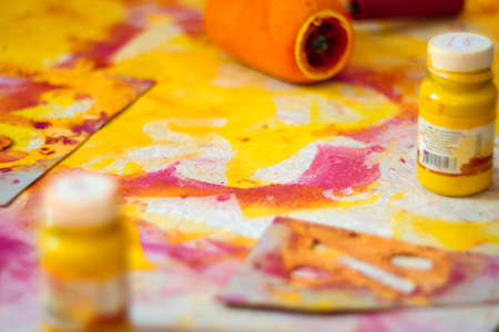A closeup of artistic instruments, paints, paint roller and paper. The concept of creativity and fantasy development. Stock Photo
