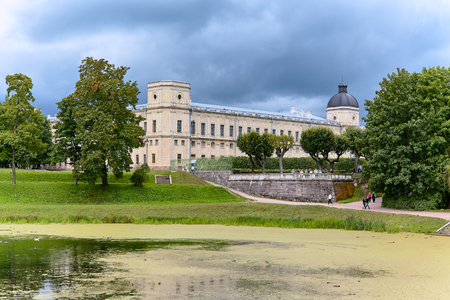 View of the Gatchina Palace from the side of the Palace Park, next to Karpin pond in autumn. St.Petersburg