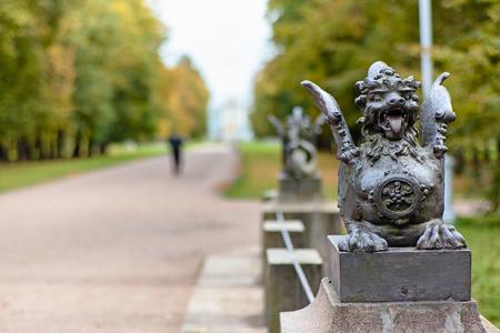Metal figure of winged dragon on the Bridge in the Alexander Park. Tsarskoye Selo, Pushkin, St. Petersburg, Russia.