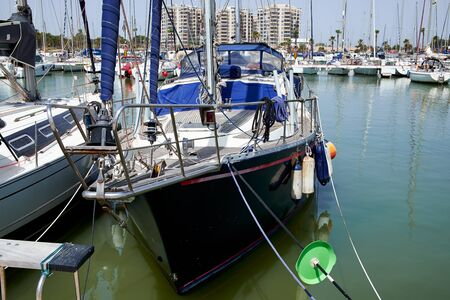 Boat and yacht on a bright sunny day in the seaport of Marina de las Dunas, Guardamar del Segura, Alicante, Spain. Stock Photo