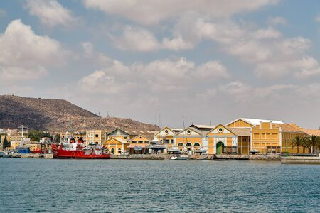 The military area with yellow buildings, in which the entrance is closed. Located in an open area near the port. Cartagena, Spain. Stock Photo