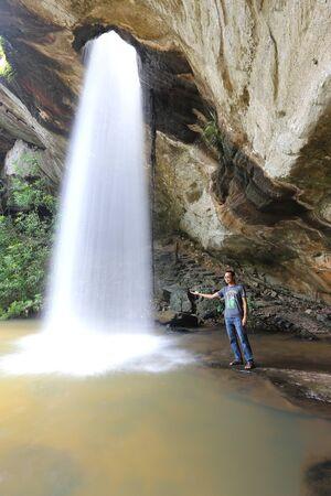 earthing: Man and waterfall Stock Photo