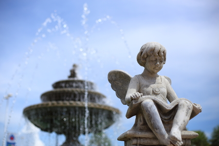angels fountain: Children statue with wings in Verona Thailand Stock Photo