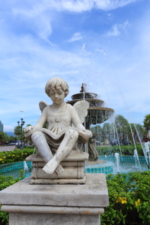 the fountain with angels: Children statue with wings in Verona Thailand Stock Photo
