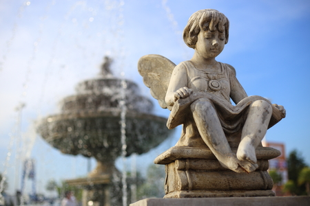 angels fountain: Baby Angel sculpture with a fountain