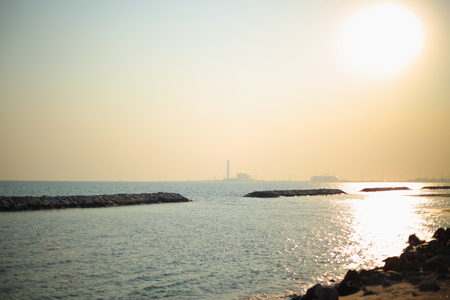 breakwater: Rock breakwater and Industrial Rayong at Thailand Stock Photo