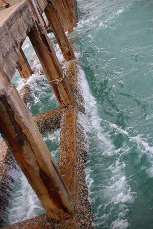 Cement bridge pier and wave in Mae Rumphueng Beach Rayong at Thailand
