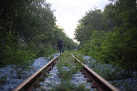 poised: The man goes on rails, maintaining a balance poised Stock Photo