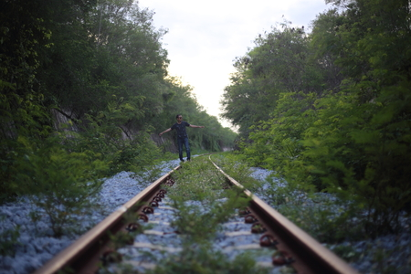 doldrums: The man goes on rails, maintaining a balance poised Stock Photo