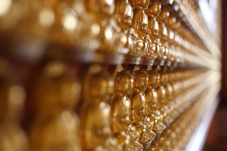 Rows Of Golden Buddha Statues at Wat Leng Nei Yi 2 in Nonthaburi, Thailand