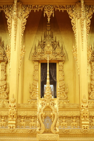 gold color window of Wat Pak Nam Jolo in Chachoengsao at Thailand.