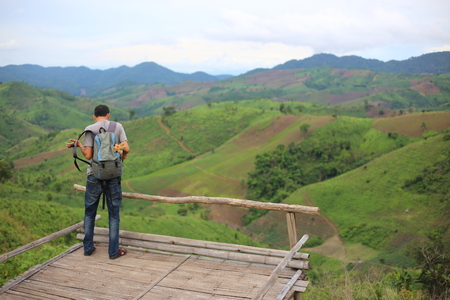 Man standing on the point of view of the mountains at Nan, Thailand