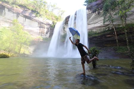 brolly: man umbrella at Huai Luang waterfall in Ubon Ratchathani, Thailand