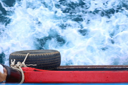 tire and Water waves behind the boat