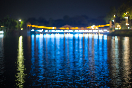 become: Suspension Bridge and the lights at night ,Blurred images