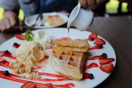 Honey waffles with fresh Strawberries and Ice Cream