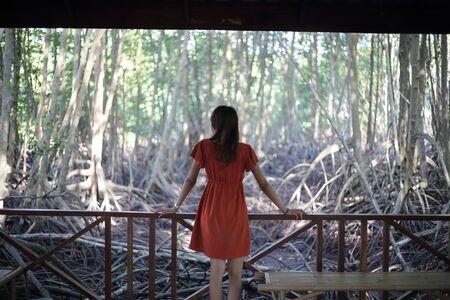 A woman standing at Tung Prong Thong at Rayong, Thailand